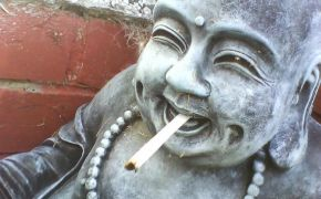 A buddha with a cigarette